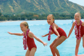 Three girls learning to surf in Waikiki
