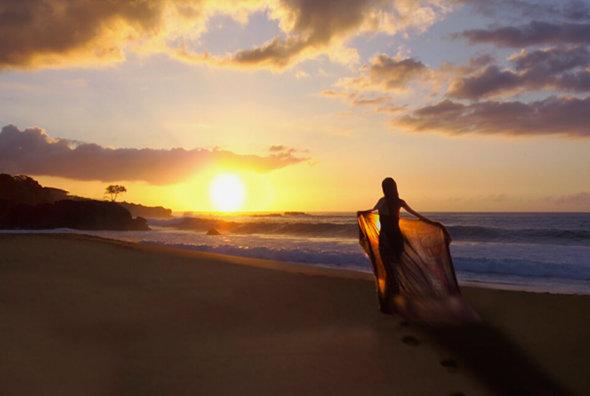 Walking on the beach at sunrise