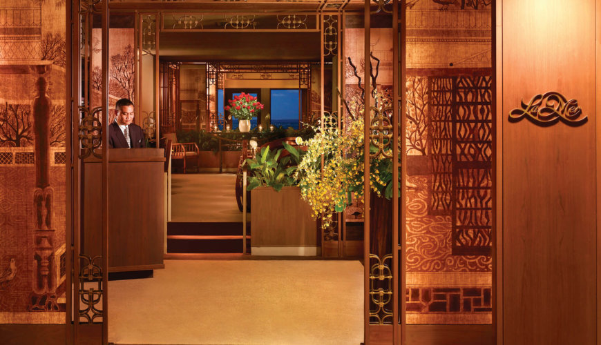 Host at the entrance of La Mer restaurant