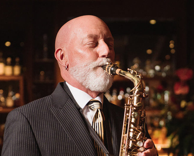 Rocky Holmes plays saxaphone at Lewers Lounge