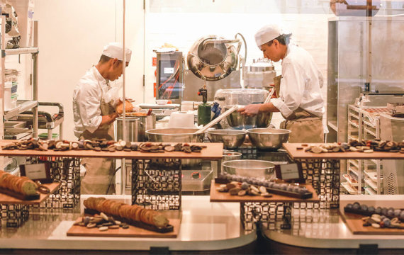 Bakery staff prepare a variety of artisan delicacies