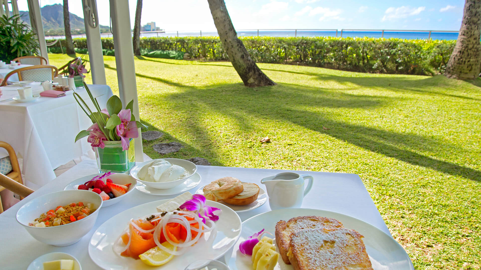 Table set for breakfast at Orchids with ocean views